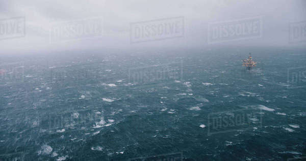 A ship sailing in the North Sea in foggy, rough conditions. Royalty-free stock photo