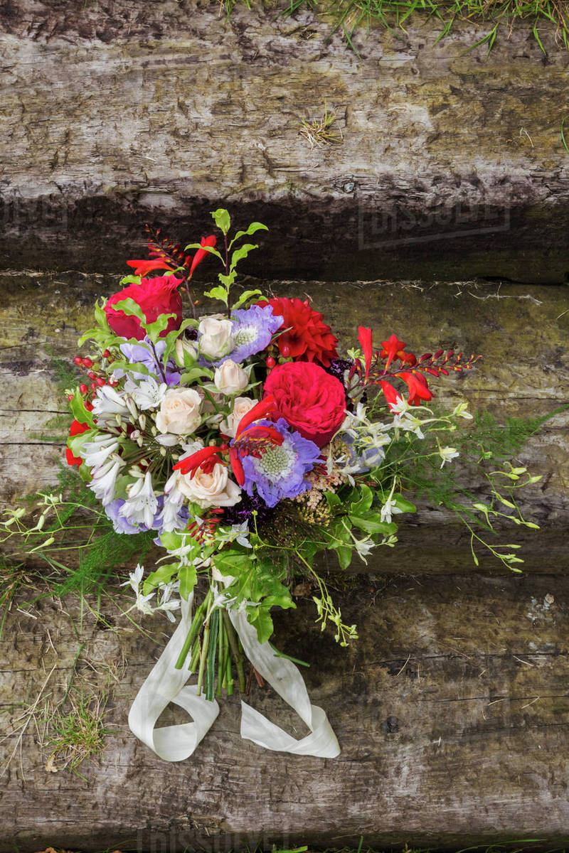 Close Up Of A Bridal Bouquet With Red White And Blue Flowers