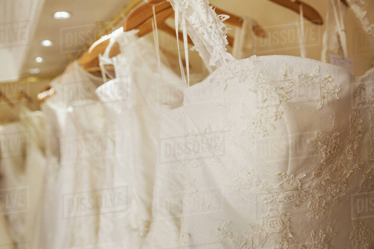 Rows of wedding dresses on display in a specialist wedding dress rows of wedding dresses on display in a specialist wedding dress shop a variety of colour tones and styles fashionable lace and boned bodices ombrellifo Gallery