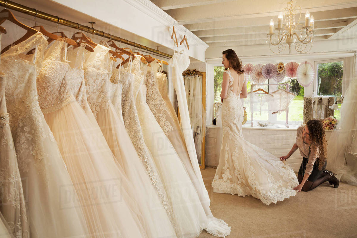 Rows of wedding dresses on display in a specialist wedding dress ...