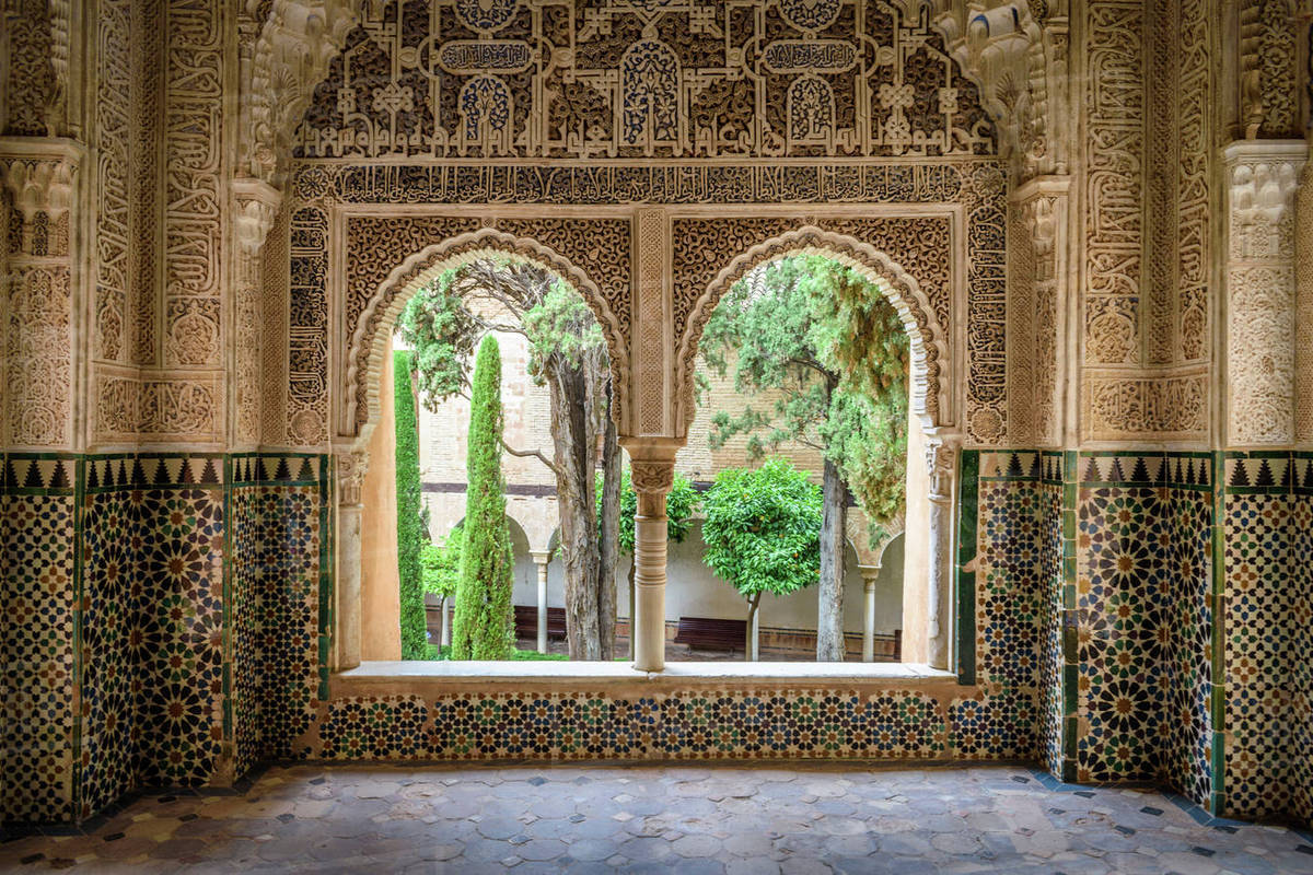 Interior view with double window and tiled walls, Alhambra palace ...