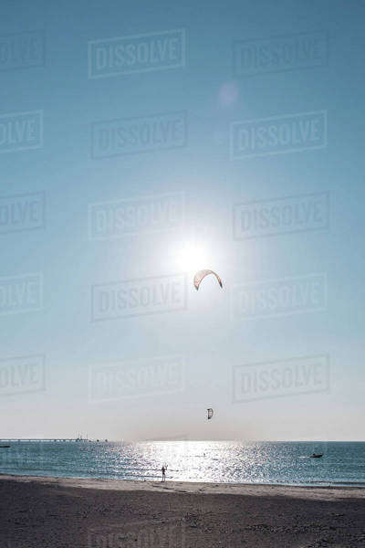 Person parasailing above a the sea Royalty-free stock photo
