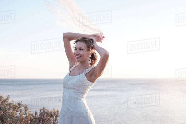 Portrait of a women posing on a coast Royalty-free stock photo
