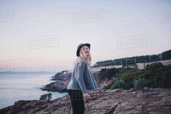Portrait of a woman posing on a coast Royalty-free stock photo
