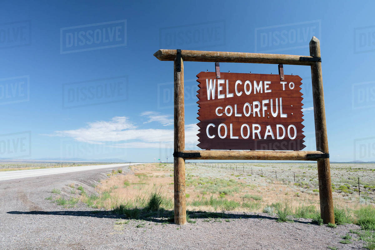 USA, Colorado, New Mexico, Border Highway 285, Clear sky over information  sign stock photo