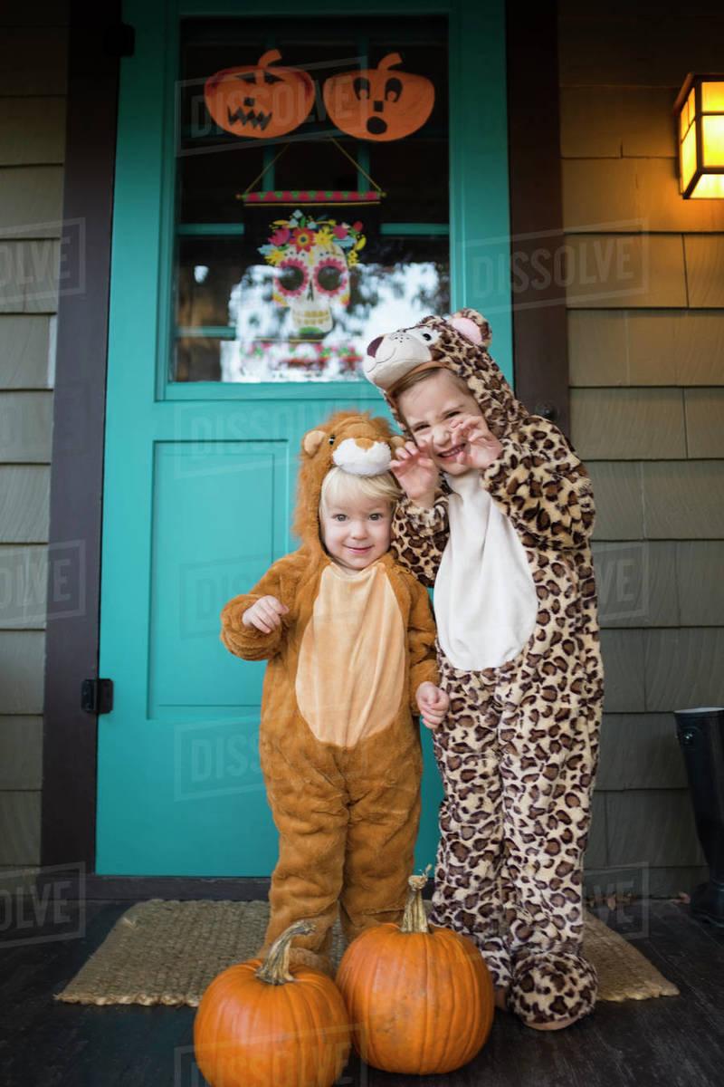 two kids (2-3, 4-5) wearing halloween costumes - stock photo - dissolve