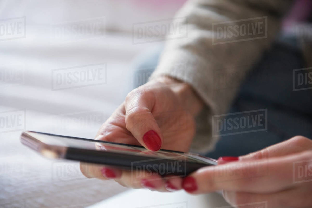 Close up of woman holding smartphone Royalty-free stock photo