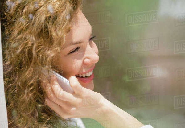Smiling young woman using mobile phone Royalty-free stock photo