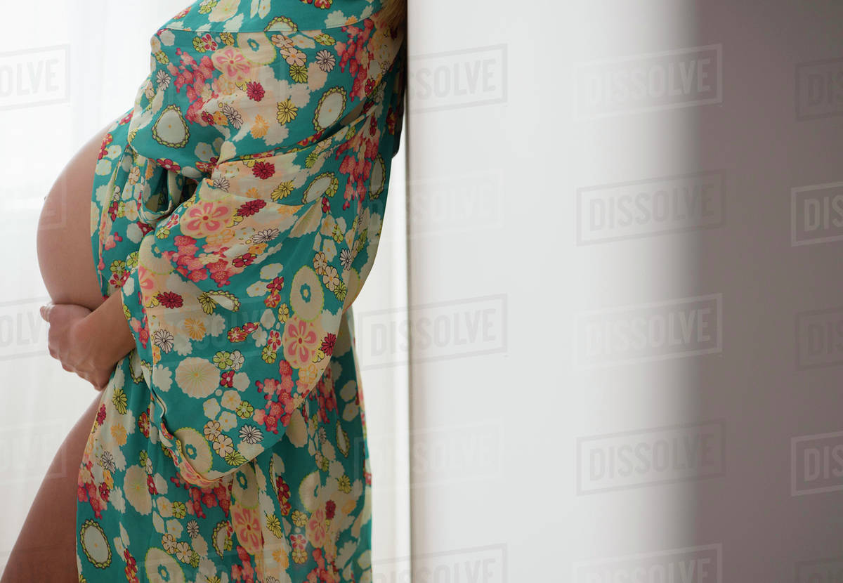 Pregnant woman in colorful dressing gown - Stock Photo - Dissolve