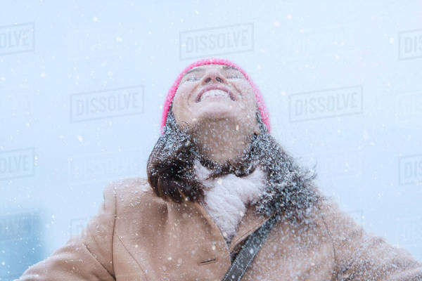 Woman in snowfall Royalty-free stock photo