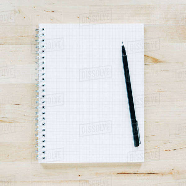 Overhead view of pen on notebook Royalty-free stock photo