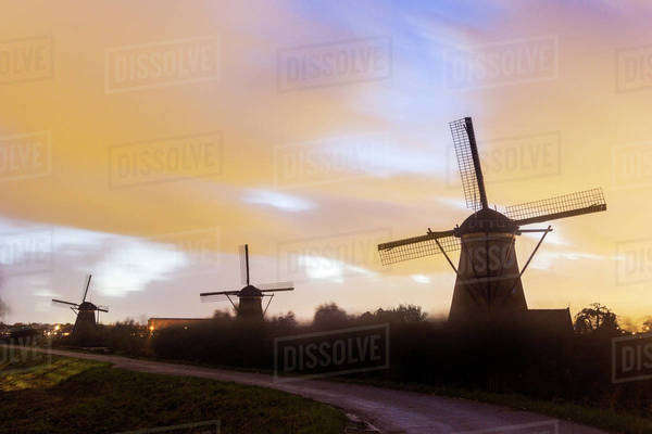Traditional windmills at sunset Royalty-free stock photo