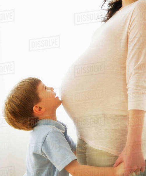 Boy (4-5) embracing pregnant mother Royalty-free stock photo
