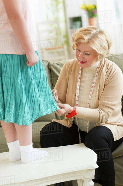 Grandmother with granddaughter (8-9) sewing together Royalty-free stock photo