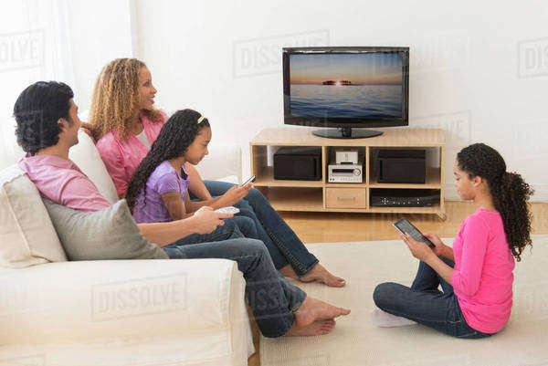 Parents with daughters (10-13) watching tv Royalty-free stock photo