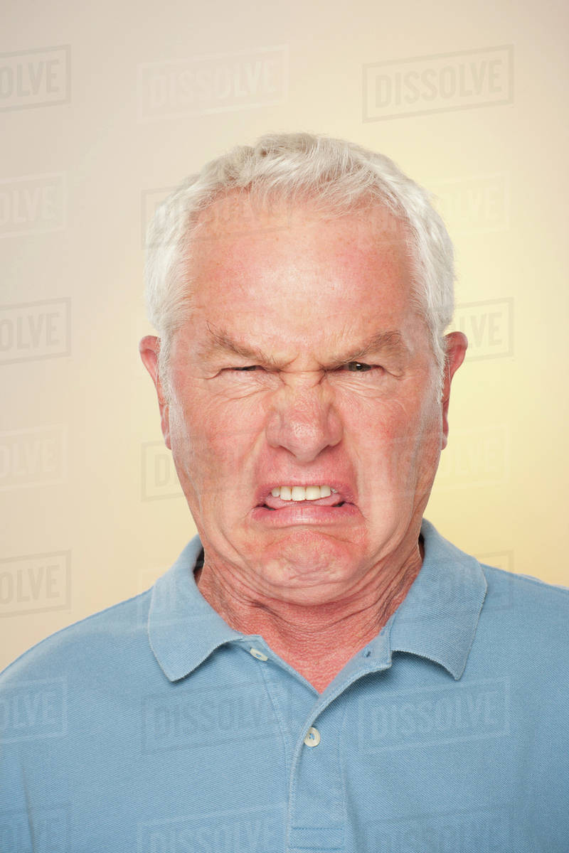 portrait of senior man with disgusted face expression stock photo