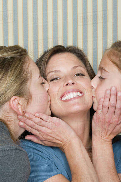 Portrait of happy mother with two girls (8-9, 14-15) Royalty-free stock photo
