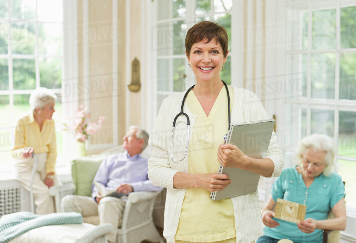 Nurse And Senior People In Nursing Home Stock Photo Dissolve
