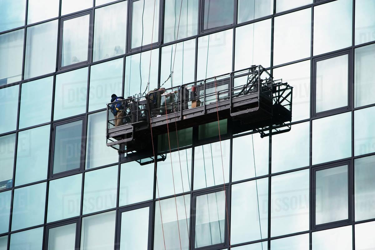 USA, New York City, Manhattan, window cleaning platform on building - Stock  Photo - Dissolve