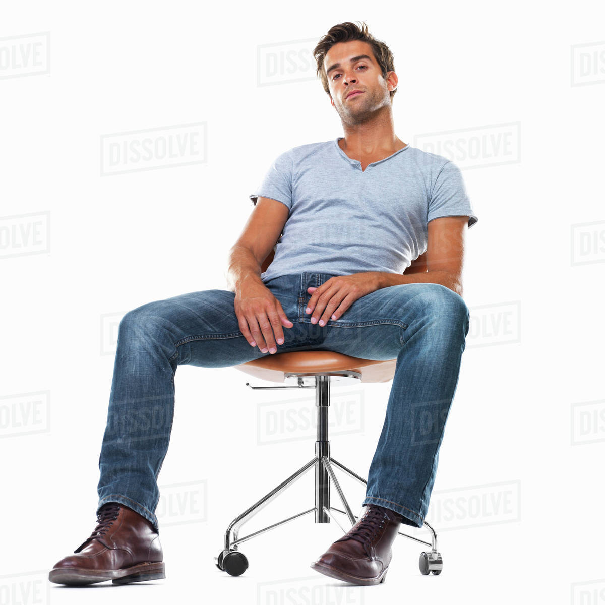 Marvelous Portrait Of Smart Young Man Sitting Comfortably On Chair Against D1028 55 790 Caraccident5 Cool Chair Designs And Ideas Caraccident5Info