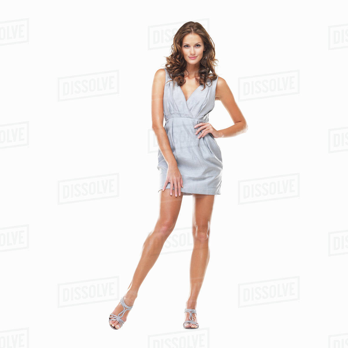 c67379a7a9 Studio shot of young beautiful woman standing on white background ...