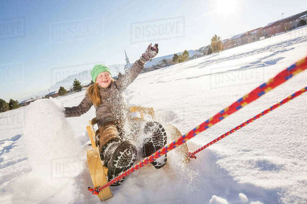 Children (8-9) riding sled Royalty-free stock photo