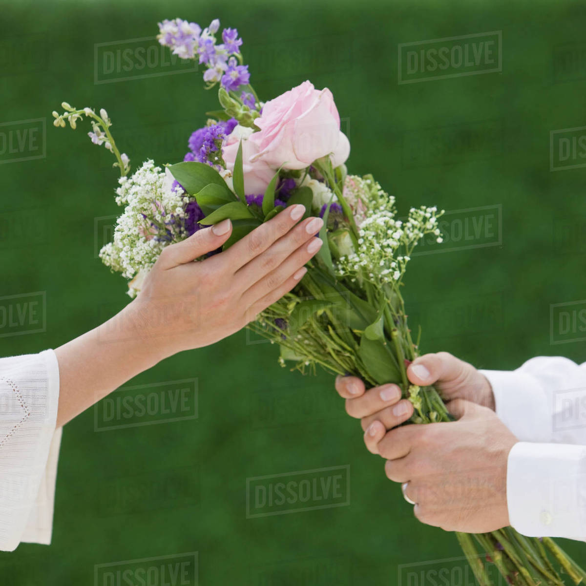 Man Giving Woman Bouquet Of Flowers Stock Photo Dissolve