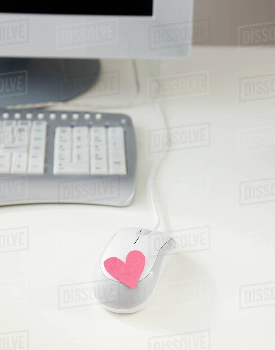 561737090e6 Heart on computer mouse - Stock Photo - Dissolve