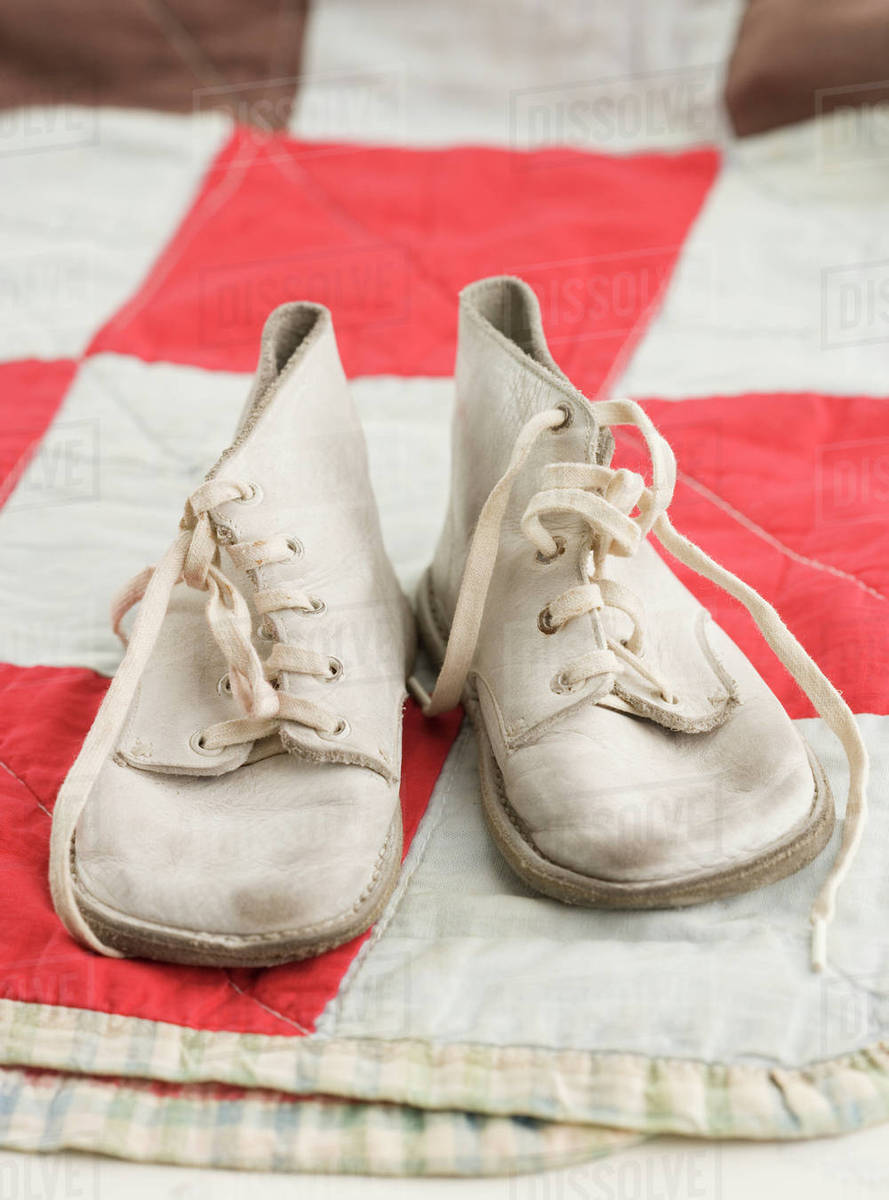 Close up of old fashioned baby shoes on