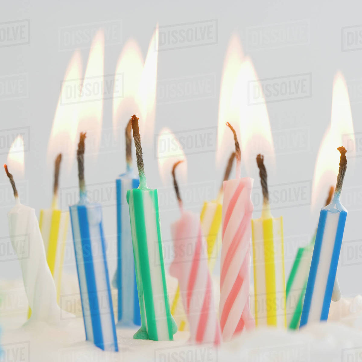close up of lit birthday candles stock photo dissolve