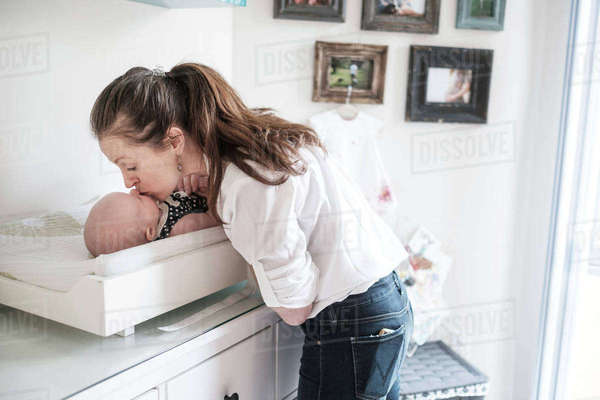 Mother kissing baby daughter (2-5 months) Royalty-free stock photo