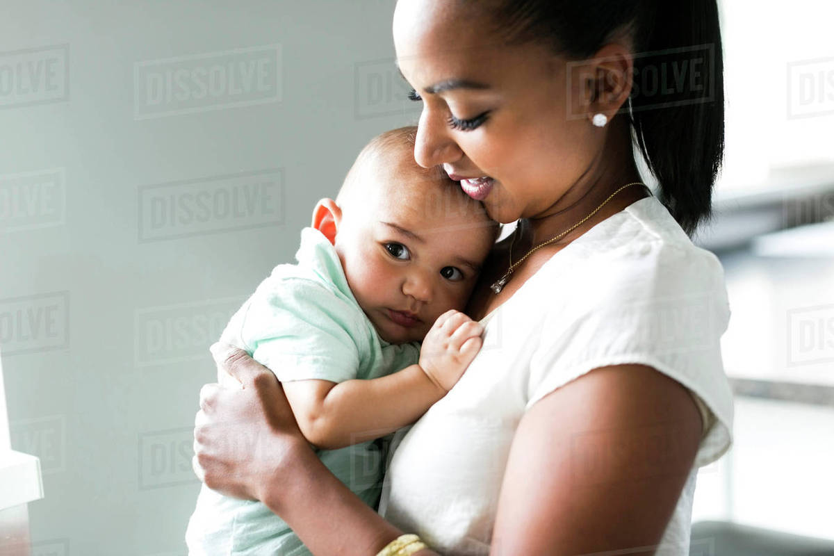 Portrait of mother holding baby boy (2-5 months) - Stock Photo ... 7beef0c1faa90
