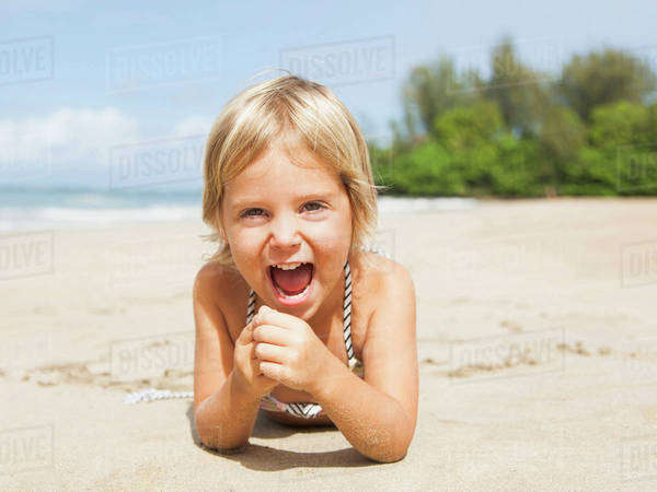 Happy girl (2-3) on sandy beach Royalty-free stock photo