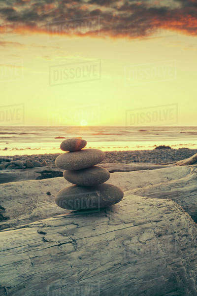 Stacked rocks on beach at sunset Royalty-free stock photo