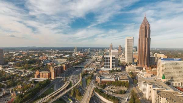 Atlanta, Georgia elevated timelapse dolly shot of Midtown Atlanta with Traffic during day. Royalty-free stock video