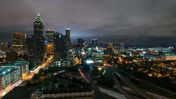 Atlanta, Georgia timelapse wide static shot of Downtown skyline with traffic & storm clouds at night. Royalty-free stock video