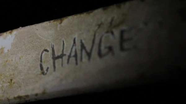Close-up shot of the word change on metal surface Royalty-free stock video