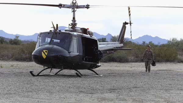 A military man walks near a helicopter. Royalty-free stock video