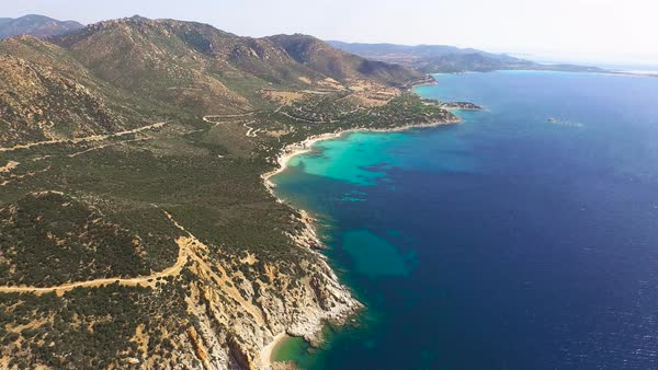 Drone fly over Sardinia coastline and colorful turquoise Mediterranean Sea Royalty-free stock video