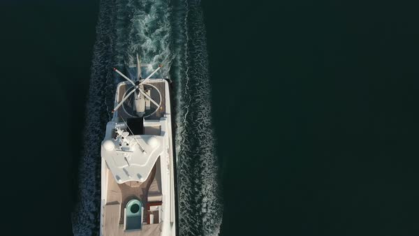 Aerial - Top down view of luxury yacht with a pool and it's own helicopter passing by Royalty-free stock video