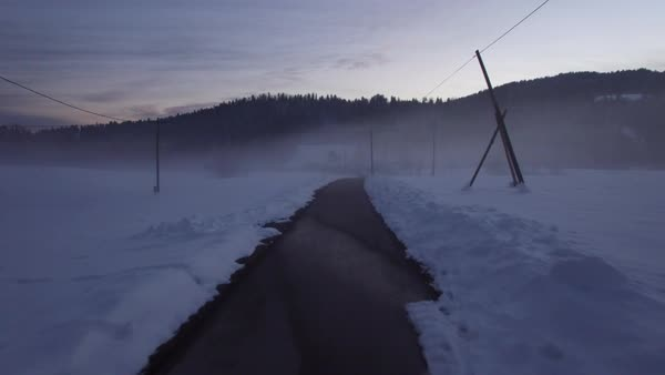 Aerial - Flying above rural asphalt road through the mist at evening Royalty-free stock video