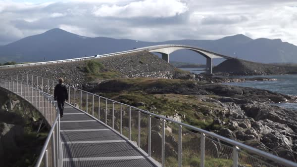Wide shot of a person walking on a bridge in Norway, Europe Royalty-free stock video