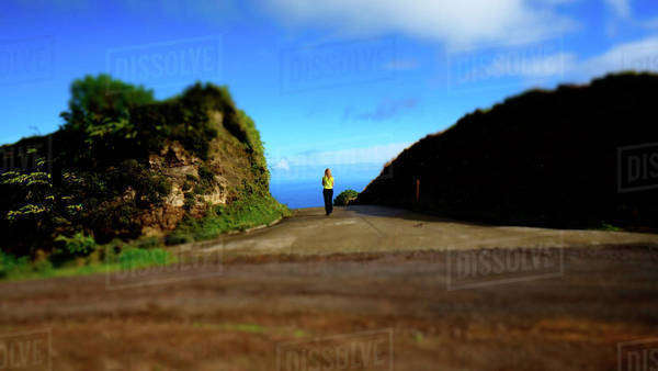 Woman walking alone on a mountain in the Sao Miguel Island in Azores, Portugal Royalty-free stock photo