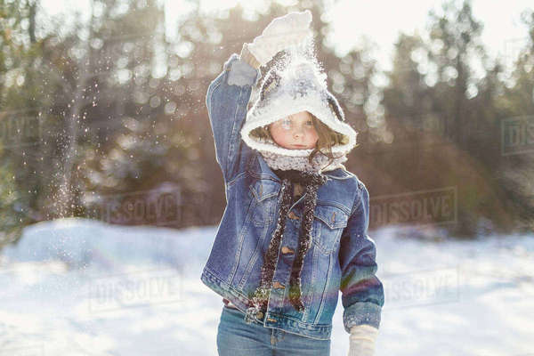Girl playing with snow while standing on field Royalty-free stock photo