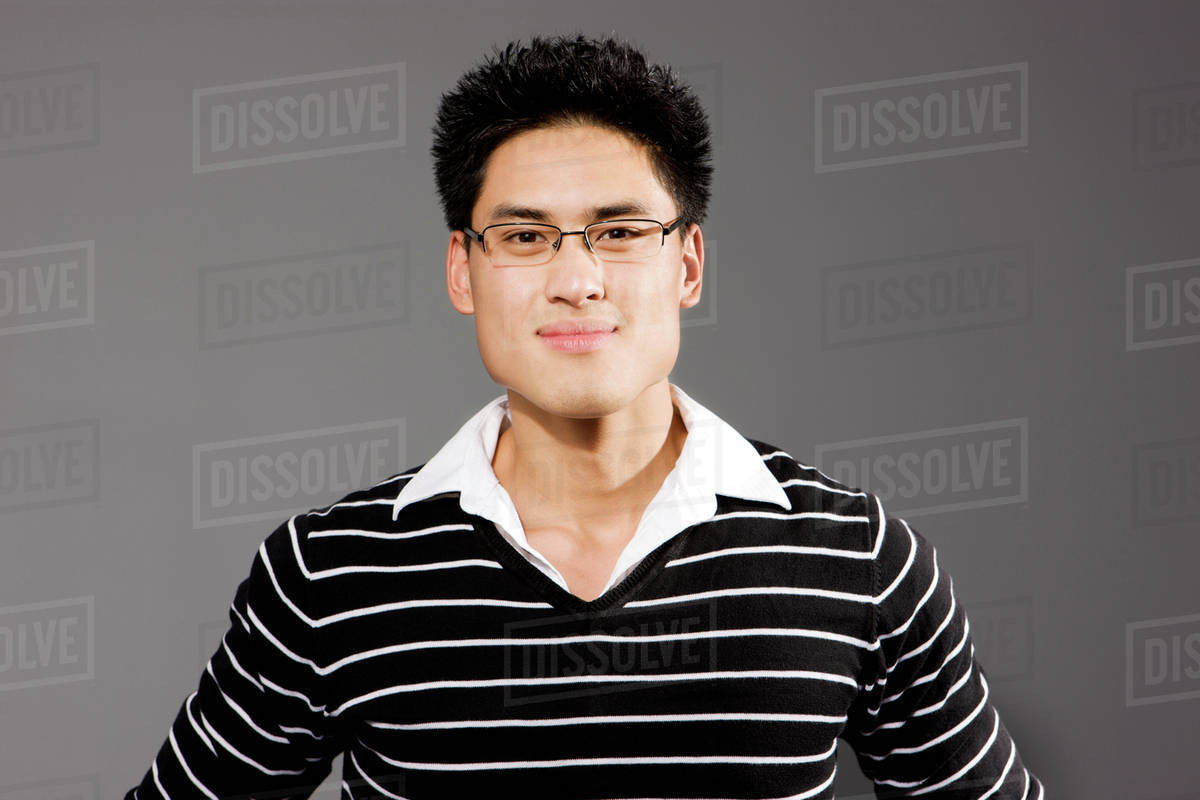 2f20f552289f Portrait of young man with glasses - Stock Photo - Dissolve