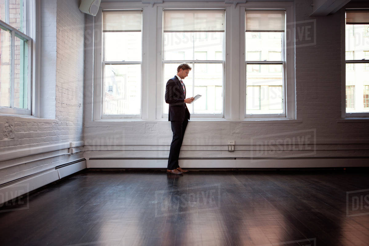 Businessman standing in empty room Royalty-free stock photo