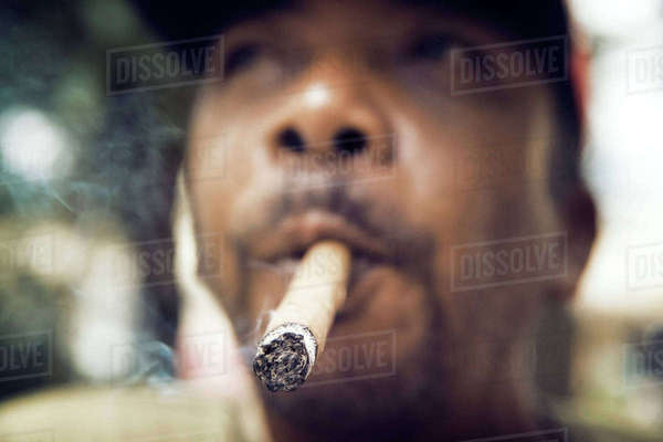 Close-up of man smoking cigar Royalty-free stock photo