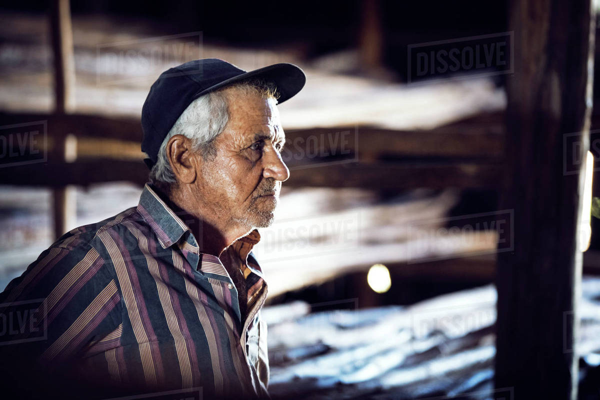 Thoughtful man standing in factory Royalty-free stock photo
