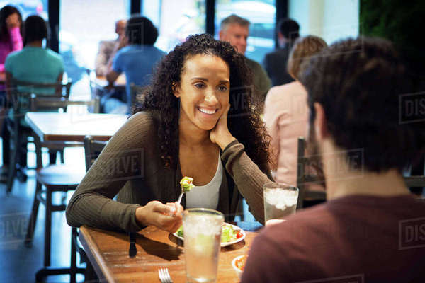 Woman sitting with man having food in restaurant Royalty-free stock photo