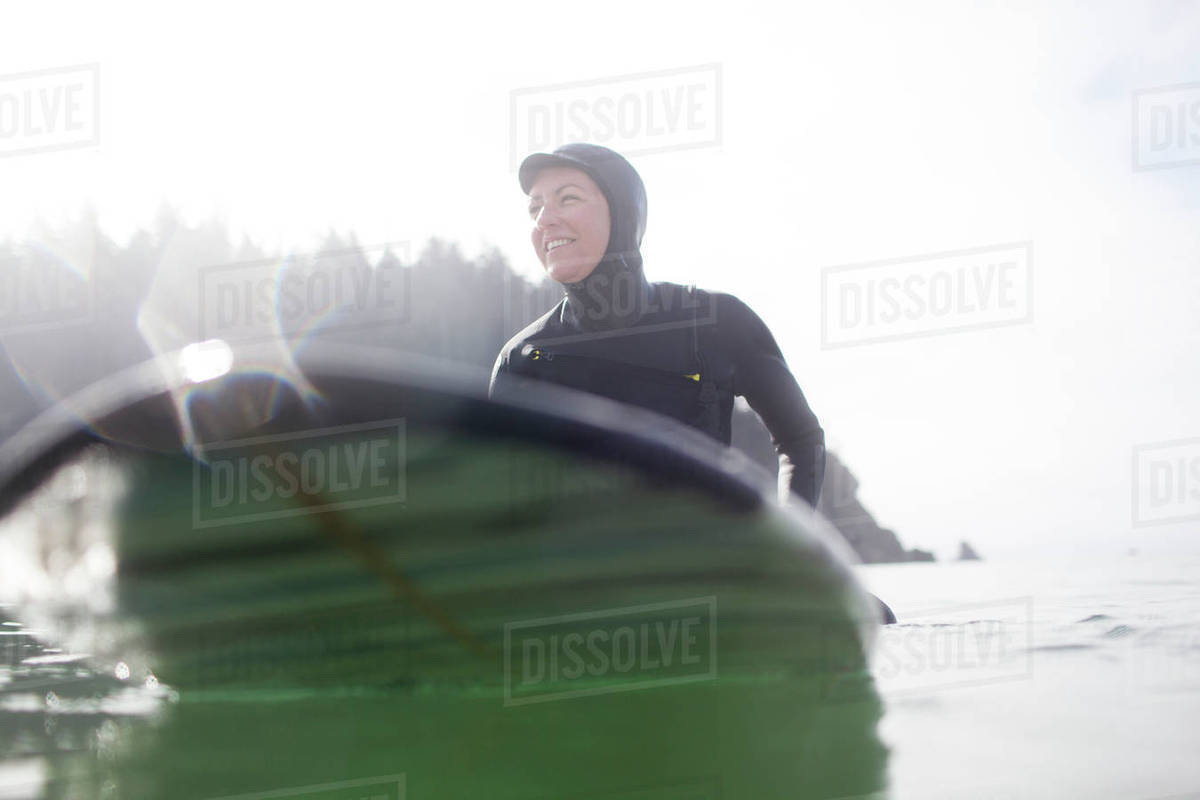 Happy woman surfboarding in sea against clear sky Royalty-free stock photo